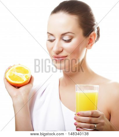 Young happy woman drinking orange juice. Isolated on white.