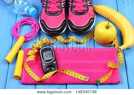 Glucometer, Sport Shoes, Fresh Fruits And Accessories For Fitness On Blue Boards, Copy Space For Tex