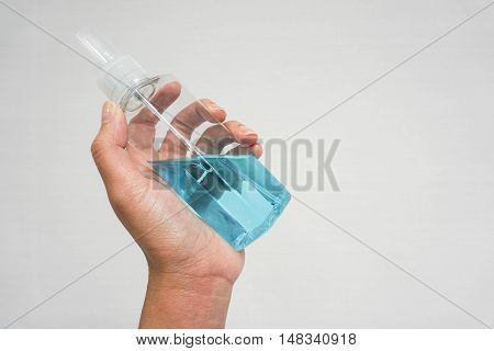 Alcohol bottle for hygiene in hand with isolated background