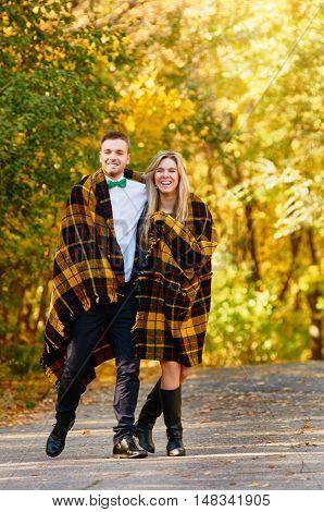 happy autumn couple in love portrait. outdoor. full length