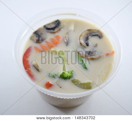 Takeout container of Thai tom kha gai soup with chicken