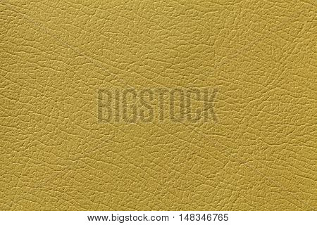 Yellow olive leather texture background with pattern closeup.
