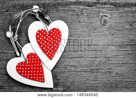 White and red sewed christmas hearts on wooden background, Holiday background for greetings Valentine's  day, place for text