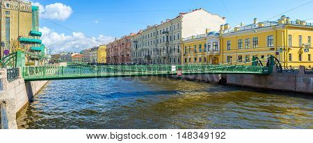 The Pochtamtsky Bridge (Postal) is a cast-iron pedestrian suspension bridge across the Moyka River named after Central Post Office (Pochtamt) St Petersburg Russia.