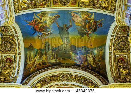 SAINT PETERSBURG RUSSIA - APRIL 25 2015: The icon on the ceiling of St Isaac's Cathedral surrounded by fretwork patterns and sculptures on April 25 in Saint Petersburg.