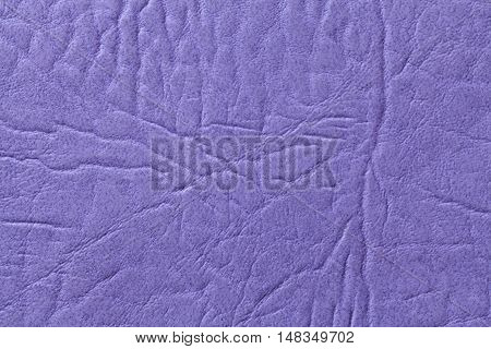 Purple leather texture background with pattern closeup.