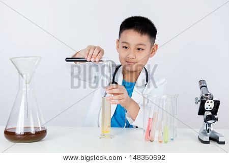 Asian Chinese Boy Holding Test Tube For Research