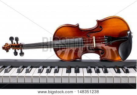 Piano keys and violin on a white background