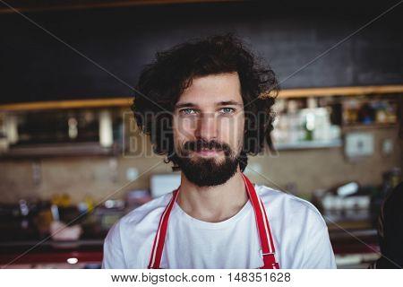 Portrait of male baker smiling in bakery shop