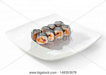 Seafood Maki Sushi - Roll made of Tuna,  Salmon, Scallop and Tobiko (flying fish roe) inside