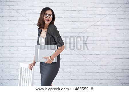 Attractive Asian business lady smiling at camera