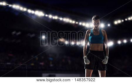 Young boxer woman at ring . Mixed media
