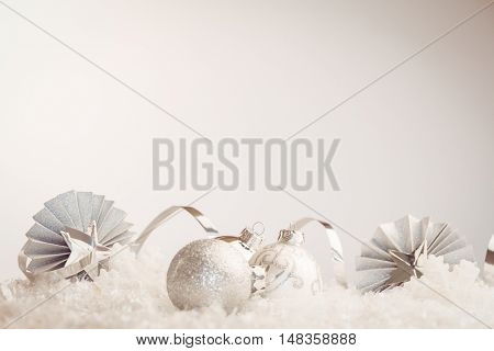 Composite image of Christmas baubles against white background