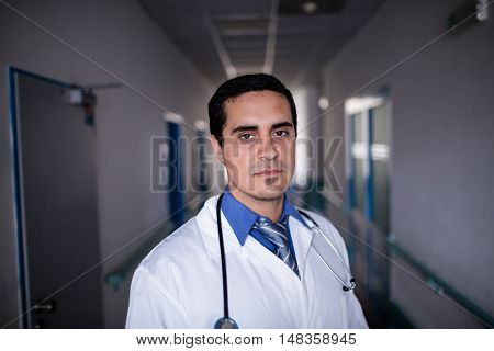 Portrait of a confident doctor standing in the hospital corridor