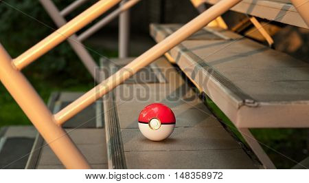 Irkutsk, Russia - September 15, 2016: Issue 2016 Image: Fan Art and Pokebol Pikachu Pokemon smartphone. Play Pokeball - this equipment to catch Pok mon in the game Pok mon go.