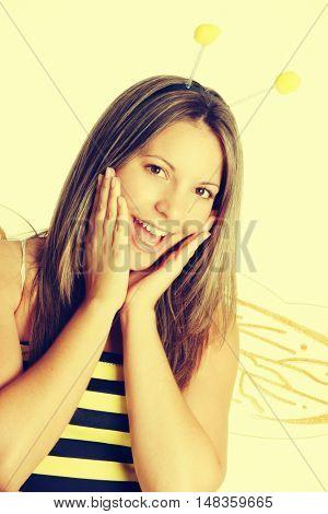 Smiling woman wearing bee costume