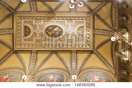 VIENNA, AUSTRIA - September 3, 2016: Detail of the magnificent ceiling above the main stairway at the State Opera in Vienna Austria