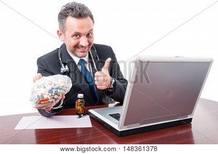 Medic At Office Showing Thumb Up And Pills Bag