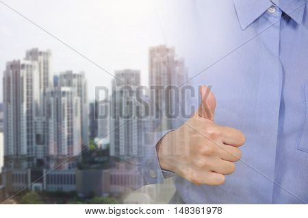 Double exposure of hand hold good sign and building in the city Business concept.