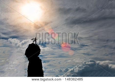 Lone Climber On The Summit Of The Mountain After The Conquest Preparing The Rope For The Descent