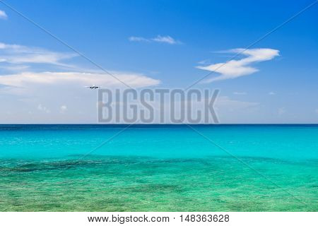 landscape of airplane landing over the sea