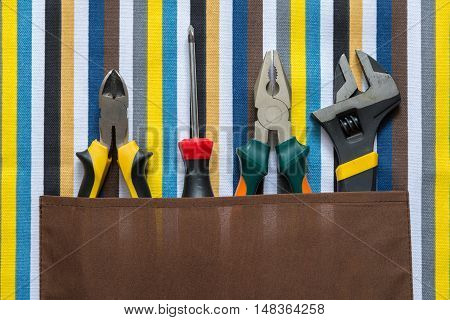 set of work tools on a colorful background