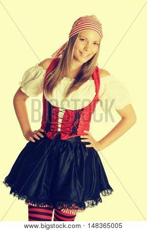 Smiling woman wearing halloween pirate costume