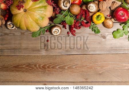 Vegetables, Nuts, Berries And  Fruits Over Old Wooden Table.