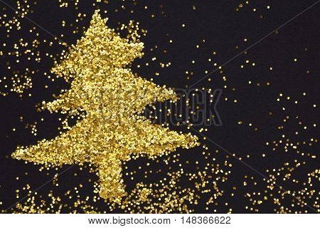 Christmas tree of golden glitter,Black background