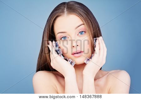 Young Healthy Woman Holding Ice Cubes. Spa and Skincare Concept