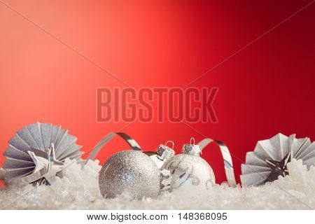 Composite image of Christmas baubles against red background