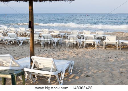 Sun loungers in a Mediterranean beach, Alicante, Spain