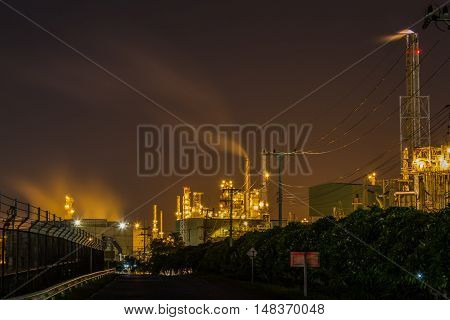 beautiful lighting of oil refinery plant in heavy petrochemical industry park use for power energy and petroleum industrial topic