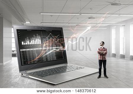 Guy and big laptop . Mixed media