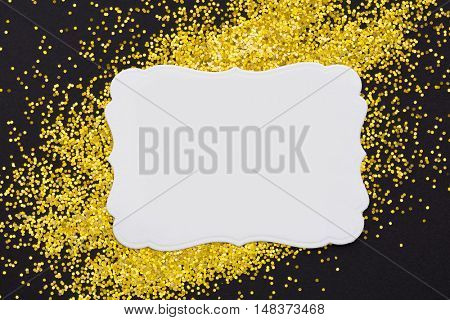 Luxury gold glitter sparkles frame on black with copy space for promotion