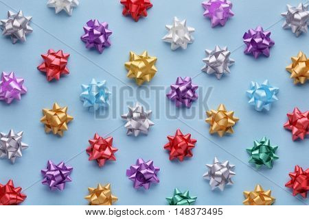 Set of colorful bows on blue. Holiday's ribbon bows for decoration gifts