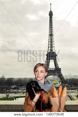 Young Fashion Model Woman with Small Dog in Paris France
