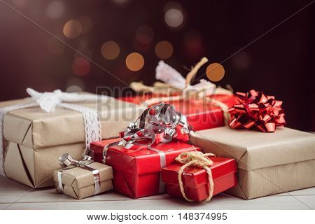 Composite image of presents on table against lightened background