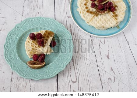 Homemade Soft Belgian Heart Shaped Waffles With Raspberries And Figs, Covered With Honey On Turquois