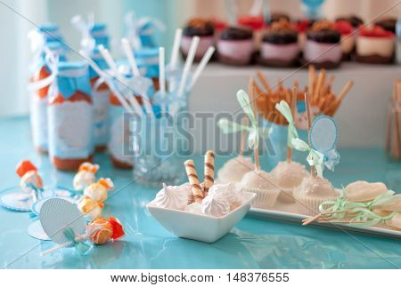 dessert table for a party. Cupcakes sweetness and flowers