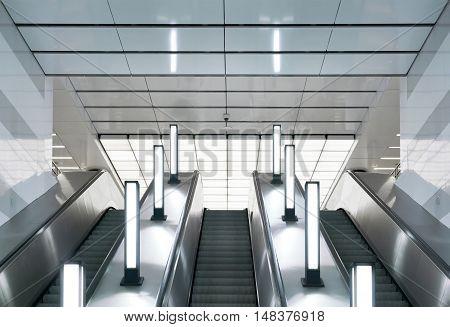 Escalator and lamps in modern urban interior