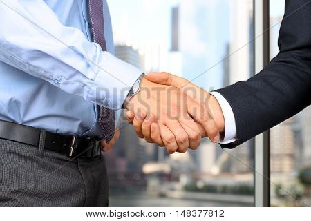 Successful business people shaking hands at the meeting