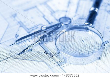 architecture blueprint -  house plans, magnifying glass & compass