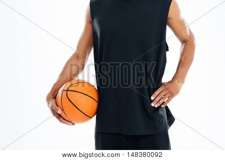 Cropped image of an african basketball player holding ball isolated on a white background
