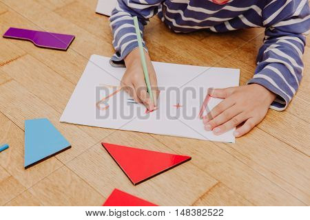 little boy writing numbers, early education concept