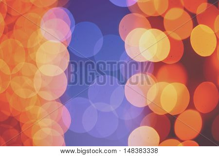 Christmas shiny light bokeh in blue, red and yellow colors, vintage retro hipster seasonal holiday background