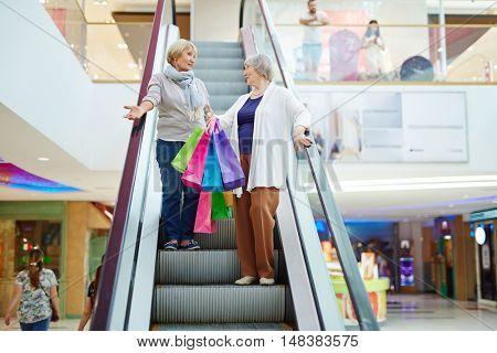 Shoppers on escalator