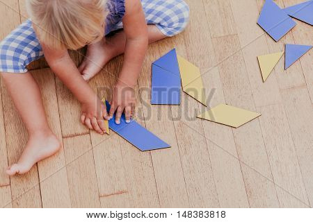 little girl playing with puzzle, early education concept