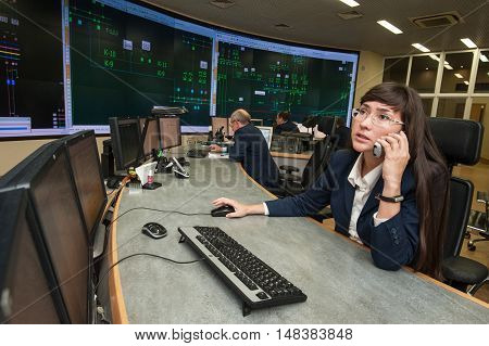 Saint-Petersburg Russia - September 22 2016: Young woman engineer controls the operation of the power system at the remote power management of the company
