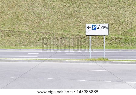 Road sign. Parking for people with disabilities and families with babies. Copy space